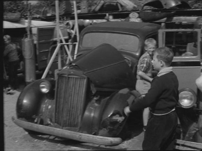 IMCDb org: 1937 Packard Six Sedan [115C] in