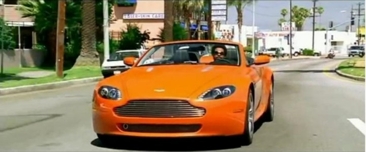V8 Vantage Roadster car - Color: Orange  // Description: costly dynamic